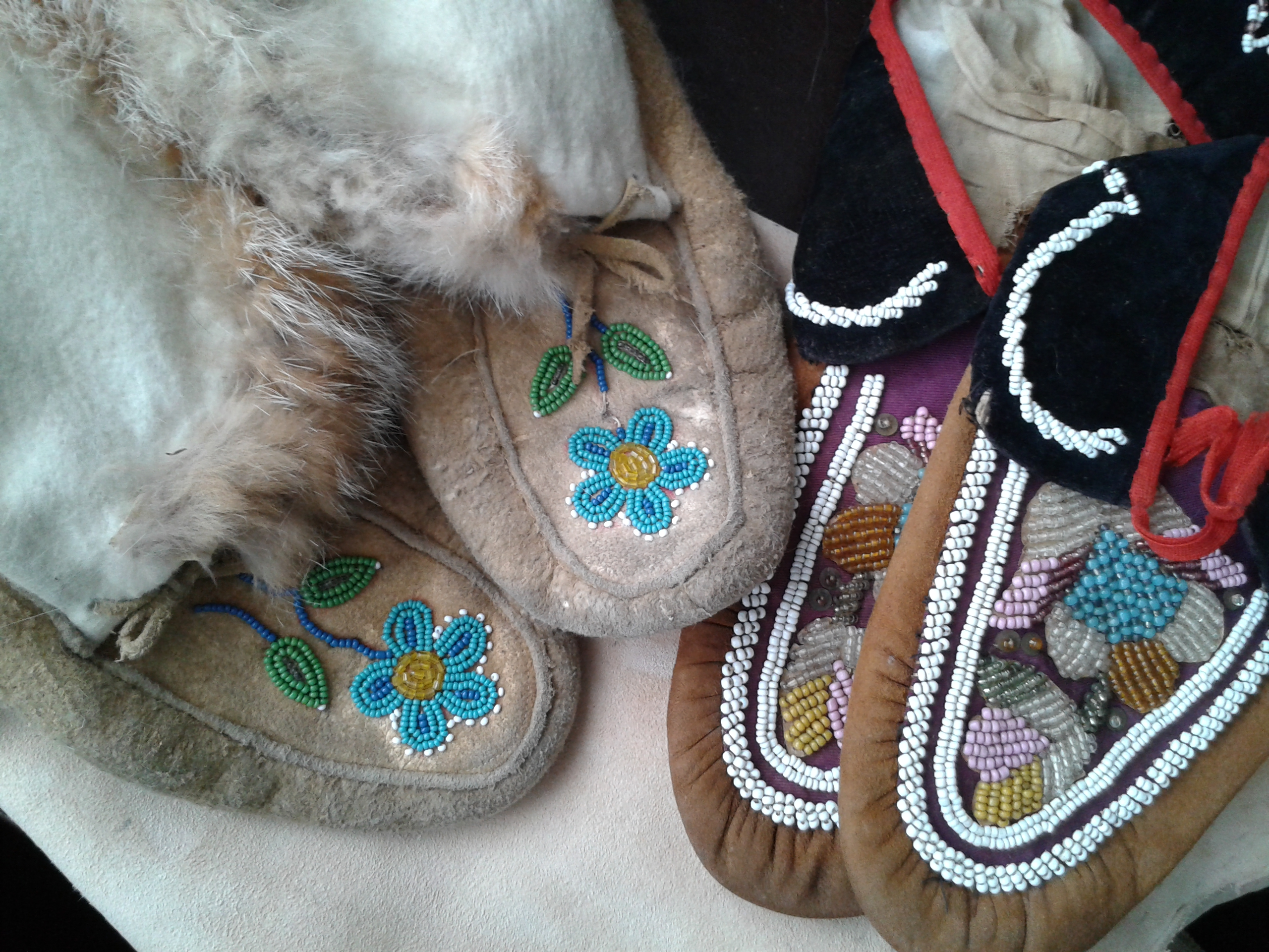 Moccasins made from braintan buckskin, with glass beads